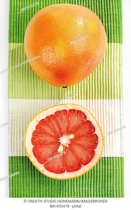 Ruby Red Grapefruits (Citrus x paradisi), whole and halved