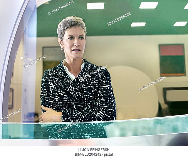Businesswoman standing at office window