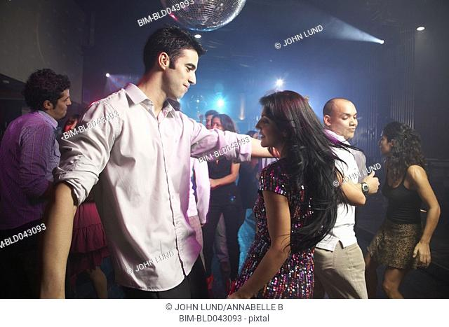 Hispanic couple dancing at nightclub