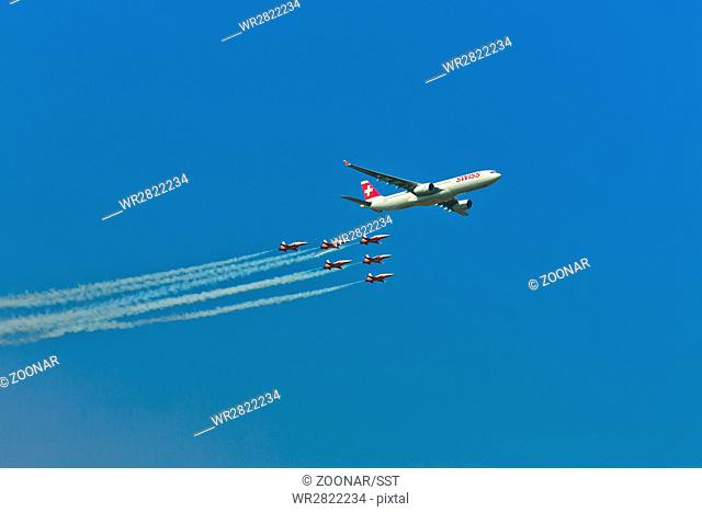 Airbus A330-300 of Swiss International Air Lines flying in formation with Patrouille Suisse at Air14