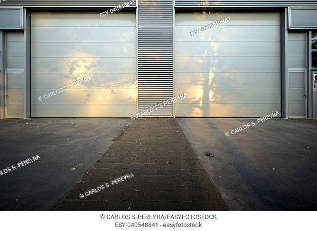 Access of metal doors to a modern industrial building in Sant Cugat del Valles in Catalonia Spain