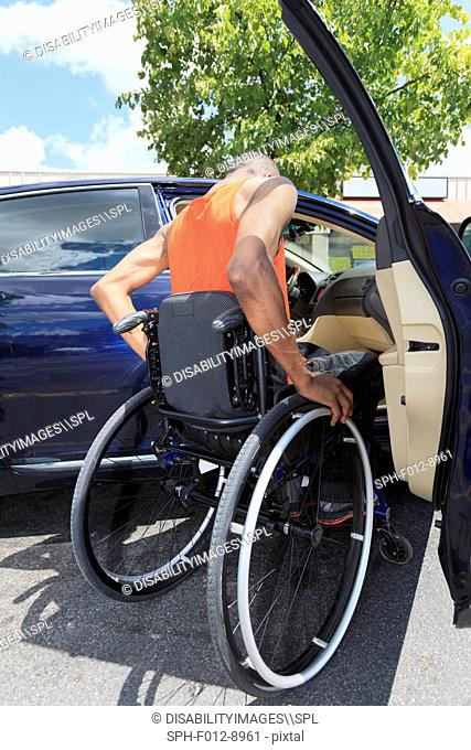 Man who had spinal meningitis in wheelchair entering a car