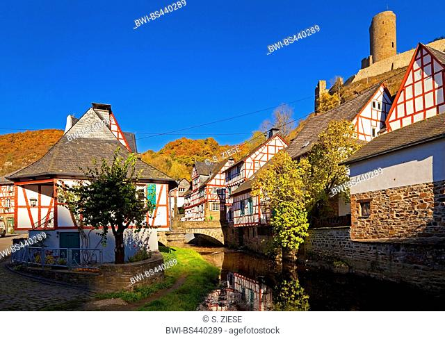 historical city of Monreal with timbered houses at river Elzbach an the ruine of castle Loewenburg, Germany, Rhineland-Palatinate, Eifel, Monreal