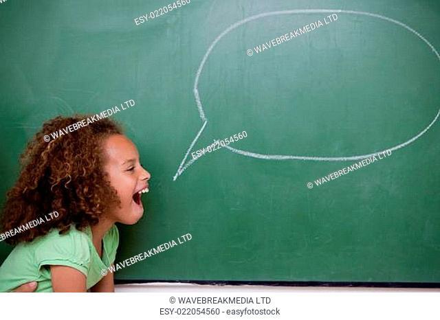 Schoolgirl posing with a speech bubble