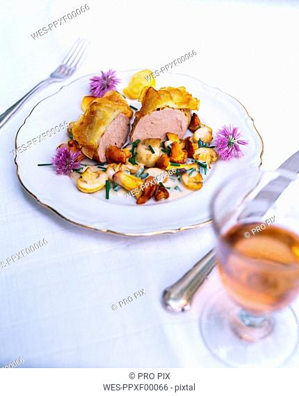 Pork fillet with potato crust and chives blossoms