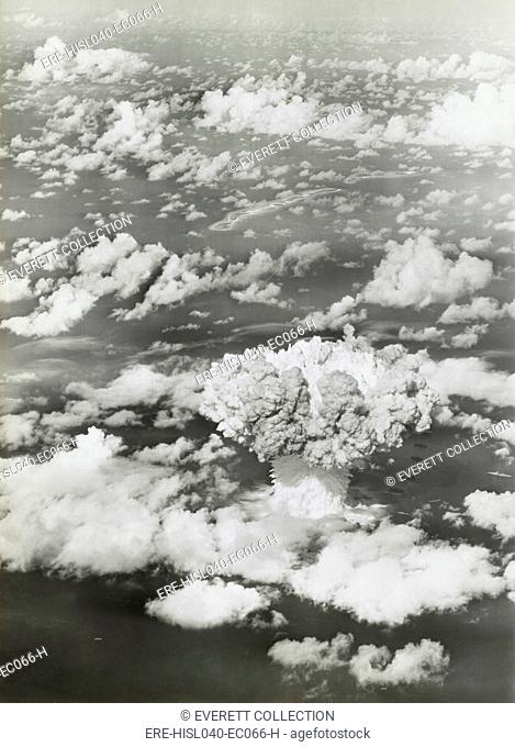 The BAKER test of Operation Crossroads, July 25, 1946. The fireball and mushroom cloud and water column emerge rise from the ocean surface