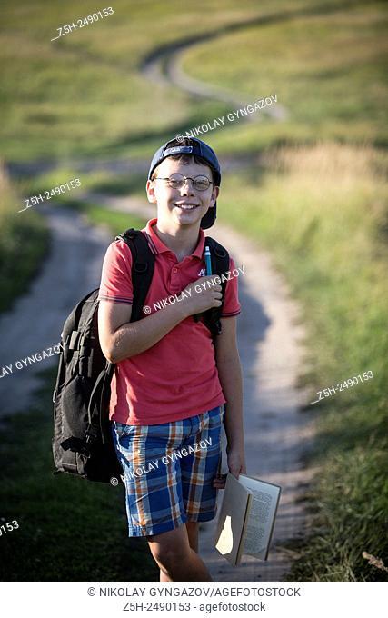 Russia. Belgorod region. Solomino village. The boy goes to the village school