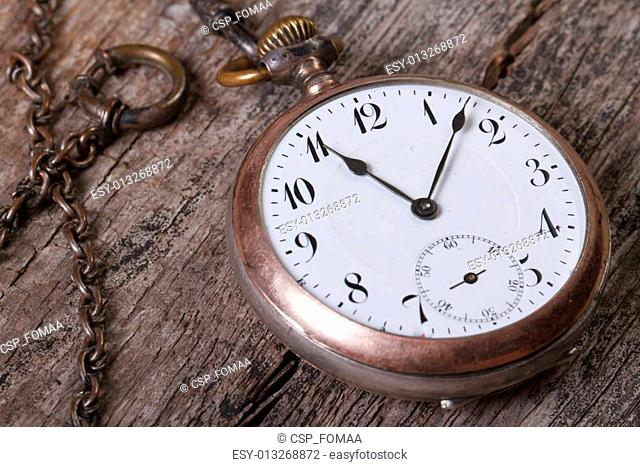 old pocket watch on a chain