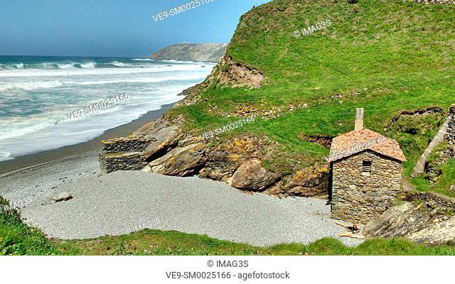 Old mill next to the waterfall, 'La Vallina' beach, Oviñana, Cudillero, Asturias, Spain