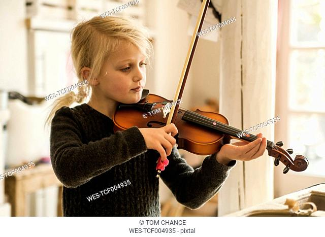 Blond girl playing violin