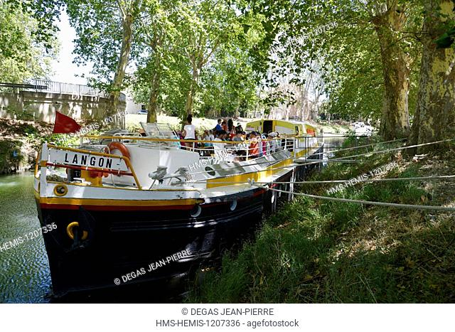 France, Herault, Beziers, Canal du Midi listed as World Heritage by UNESCO, tourist barge which welcomes a center holidays for children