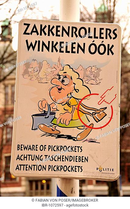 Sign, beware of pickpockets in the city centre of Amsterdam, Holland, Netherlands, Europe