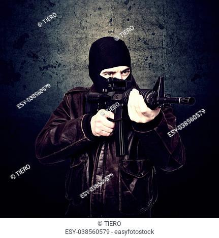 portrait of terrorist and grunge background