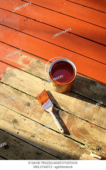 Re-staining old wooden deck DIY project painted into corner