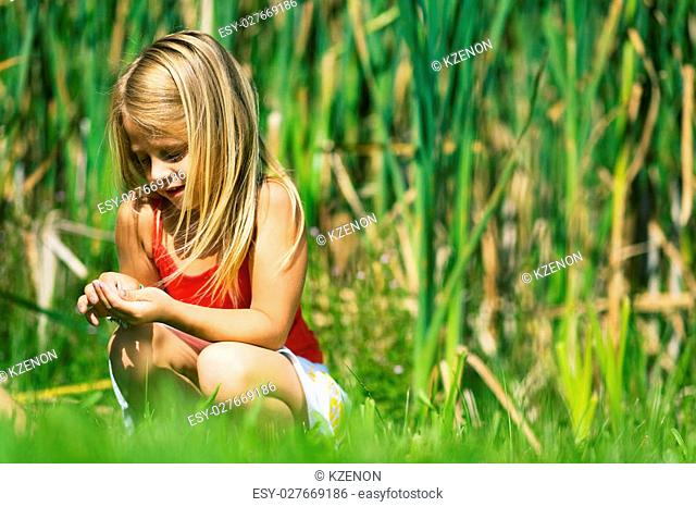 girl sitting in the reed
