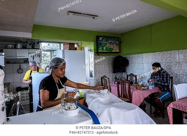 Angela Maria Carneiro Barbosa (front) and Antonia Lima (back) working in the restaurant Visual in the favela Rocinha, one of the biggest in Rio with 250