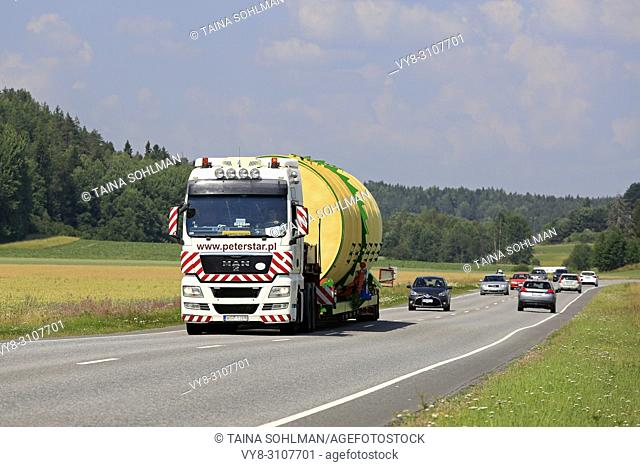 Wide load transport of a silo by MAN TGX 26. 540 semi trailer of Peter-Star, Poland on the road in South of Finland. Salo, Finland - July 27, 2018