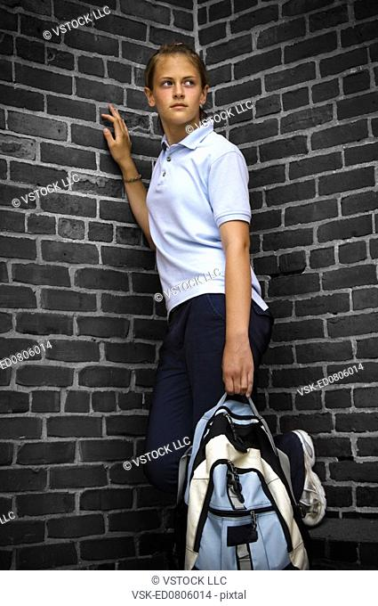 Girl in school uniform wearing a backpack