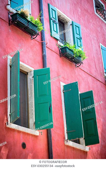 Nice mediterranean house facades with shutters and different colours