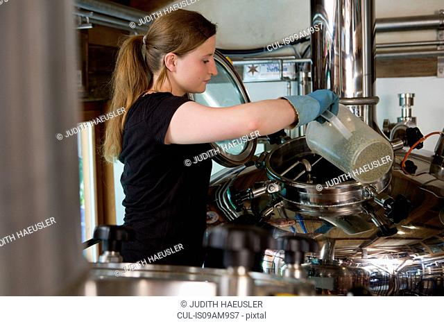 Female brewer working in brewhouse