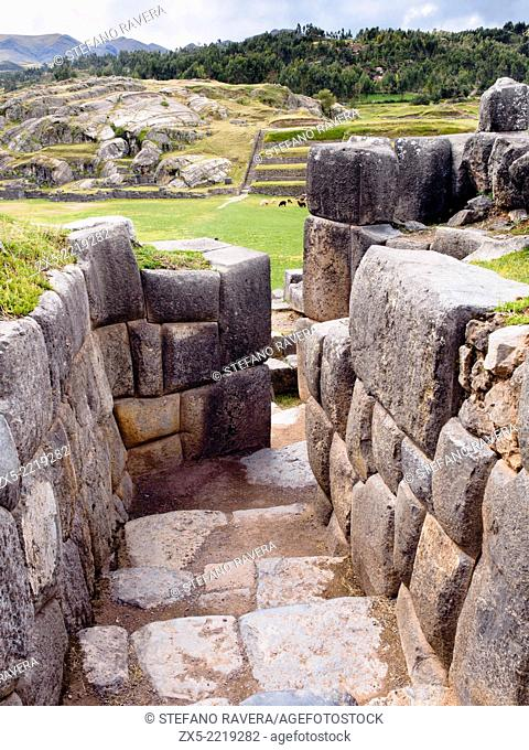 Large polished dry stone walls of the Saksaywaman military Inca complex - Cusco, Peru