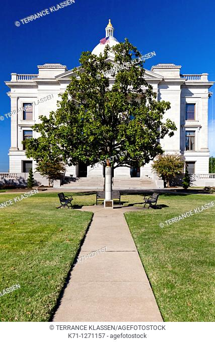 A lone tree and the Eternal Flame of Freedom at the Arkansas State Capitol grounds in Little Rock, Arkansas, USA