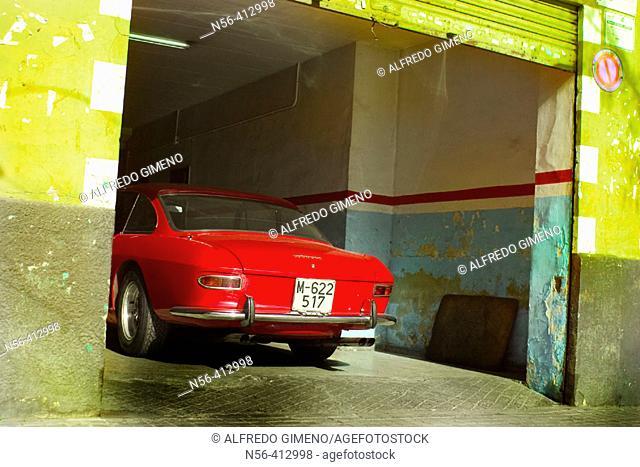 Old red car in garage