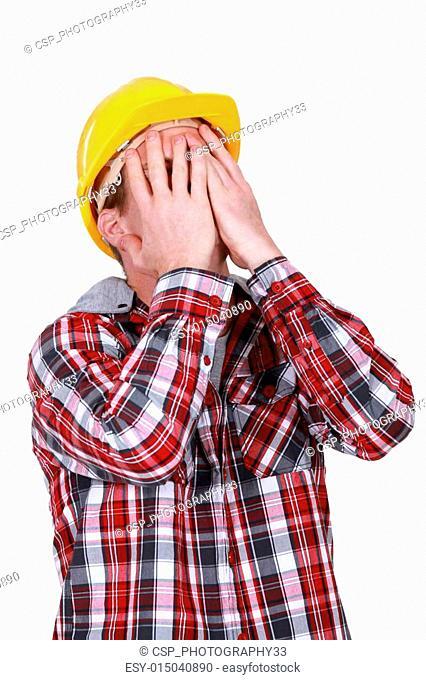 Devastated construction worker