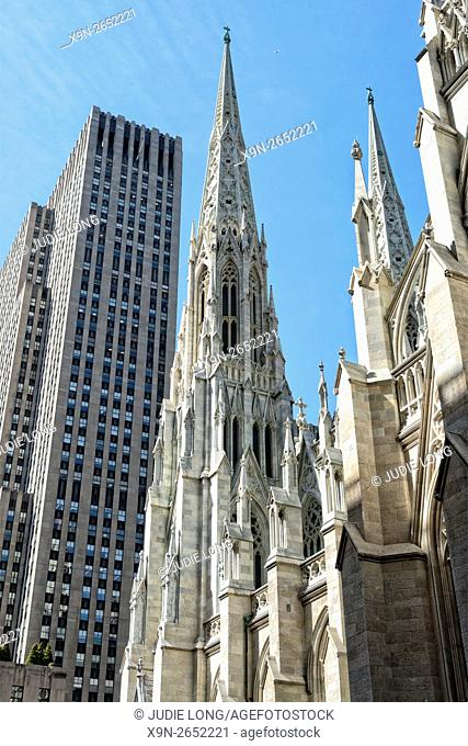 Looking at the South Side Spire of St. Patrick's Cathedral, from East 50th Street, Manhattan, New York City. Rockefeller Center in the Background