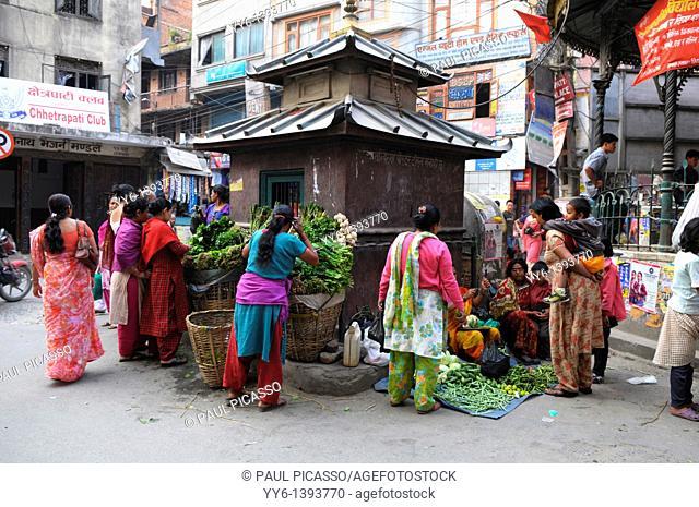 morning market in the front of street shrine , kathmandu, nepal