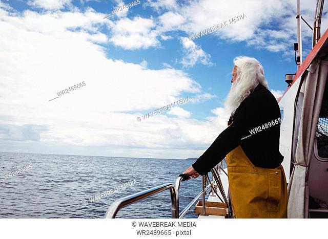 Fisherman looking at view