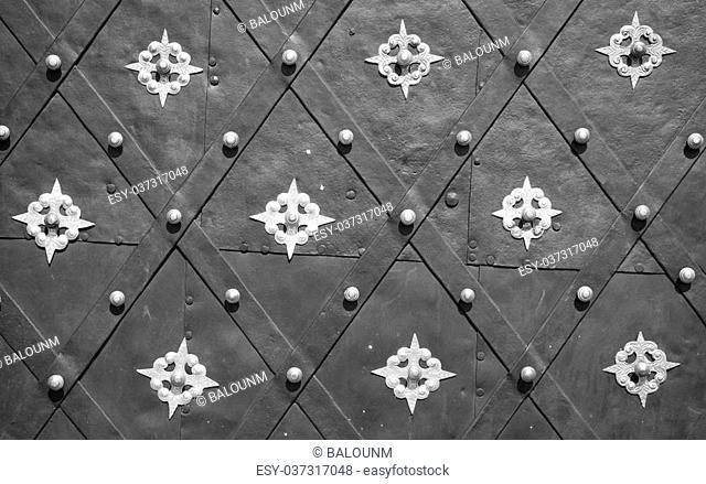 Antique decorated metal door background