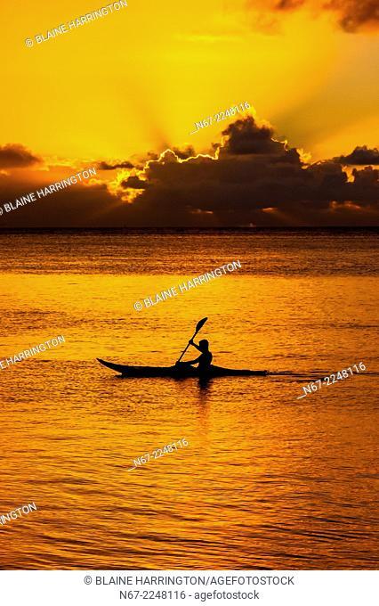 Sea kayaking at sunset, island of Moorea, French Polynesia