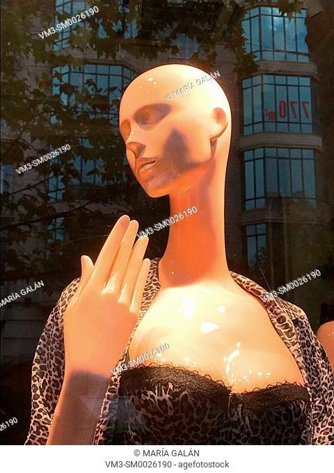 Mannequin in a shop window. Serrano street, Madrid, Spain