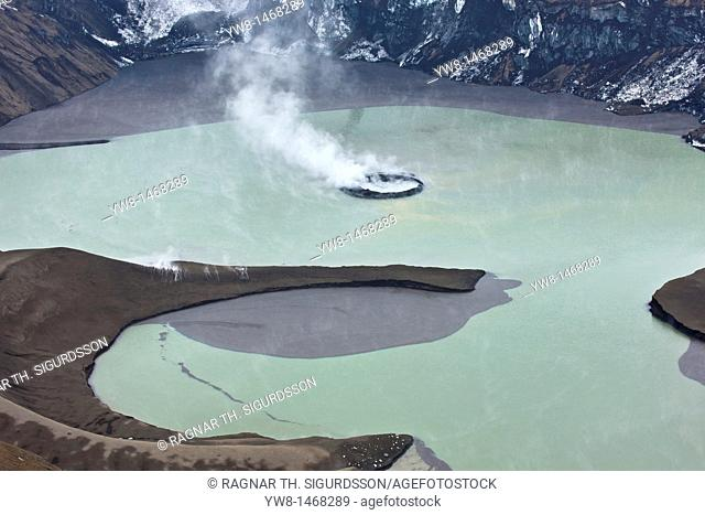 Grimsvotn crater steaming in lake, Grimsvotn volcanic eruption, Iceland  Eruption began on May 21, 2011 spewing tons of ash