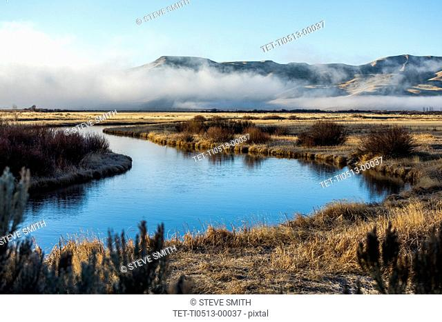 River and mountain under fog in Picabo, Idaho