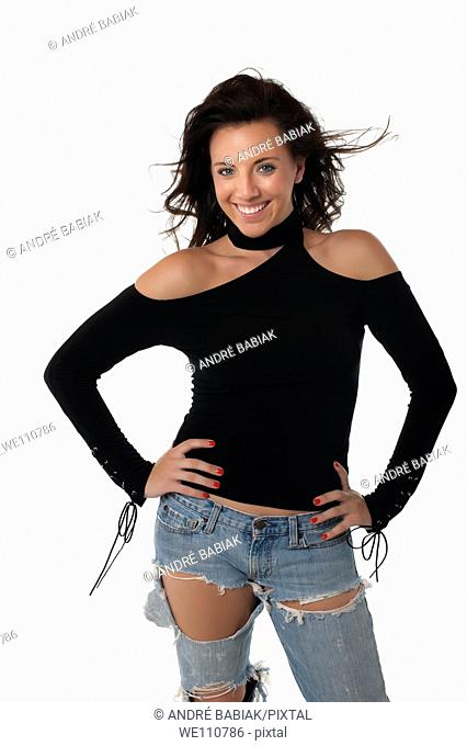 Sexy young woman in worn jeans and black top
