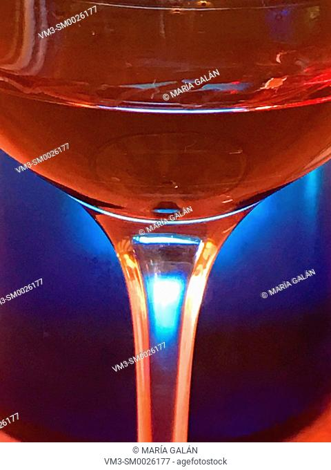 Glass of red wine against blue background, Close view
