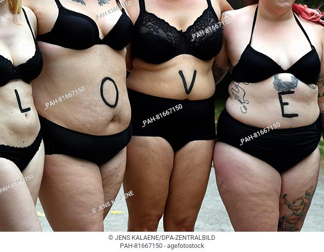 Plus size models pose in the context of the photo project 'Bodylove' for a realistic women image at the Marx-Engels-Forum in Berlin, Germany, 30 June 2016