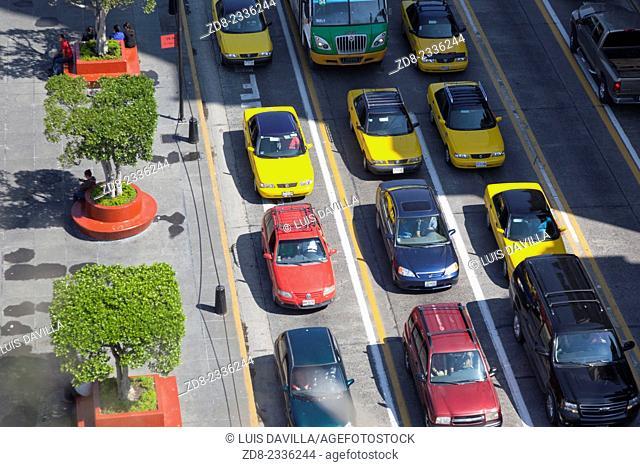 trafict in Guadalajara's Main Square, the Plaza de Armasl