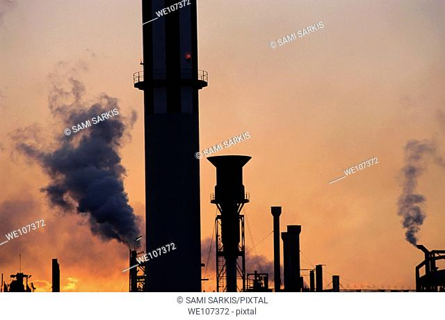 Smoking chimneys of a petroleum refinery at sunset, Berre, France