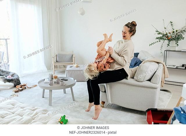 Mother and daughter playing together