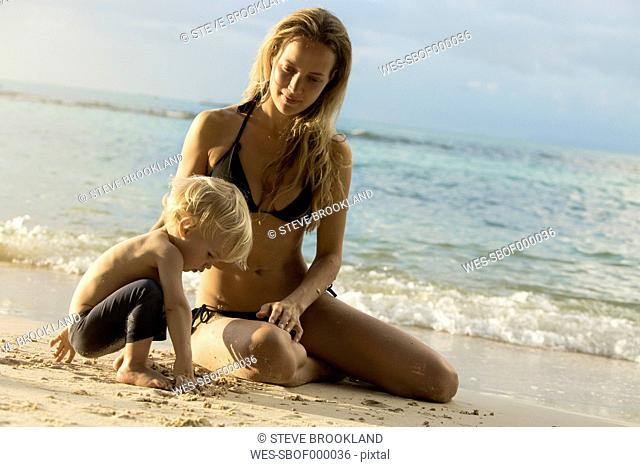 Thailand, mother and son on beach