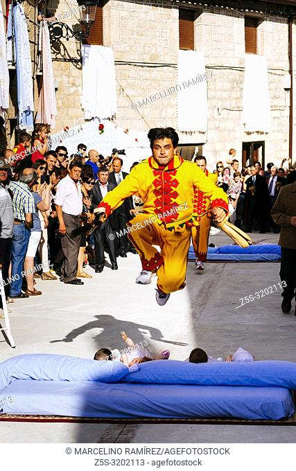 The colacho feast. Babies born during the last twelve months are placed on mattresses on the floor. The Colacho, dressed as a demon