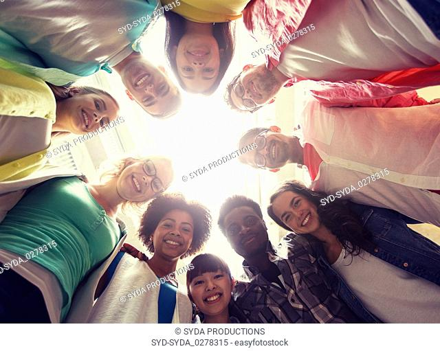 group of international students standing in circle