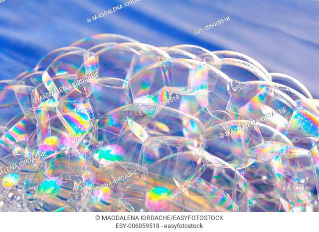 bright soap bubbles on blue background