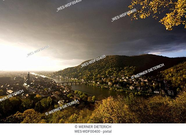 Germany, Baden-Württemberg, View over Town with Necker river and thunderclouds