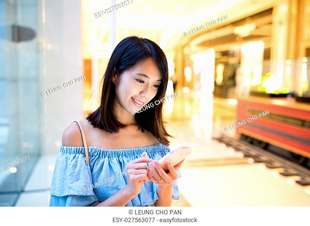 Young Woman sending sms on mobile phone