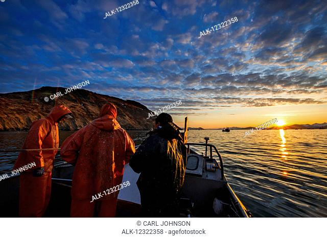 The sun rises over Kulukak Bay in the Bristol Bay region as a commercial fishing crew and skipper prepare for another day of fishing, Southwest Alaska, USA