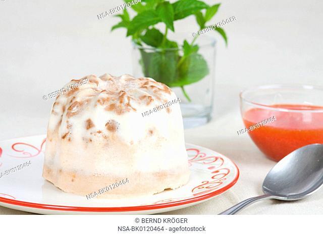Bundt cake parfait with white and dark chocolate and raspberry sauce